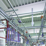An Overhead Monorail System, Balancers and Retractors are in use in a assembly line
