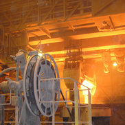 A Motor-Driven Reel in front of a Process Crane in the Metallurgy industry